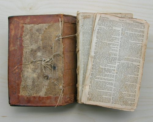 Photograph of a book before repair